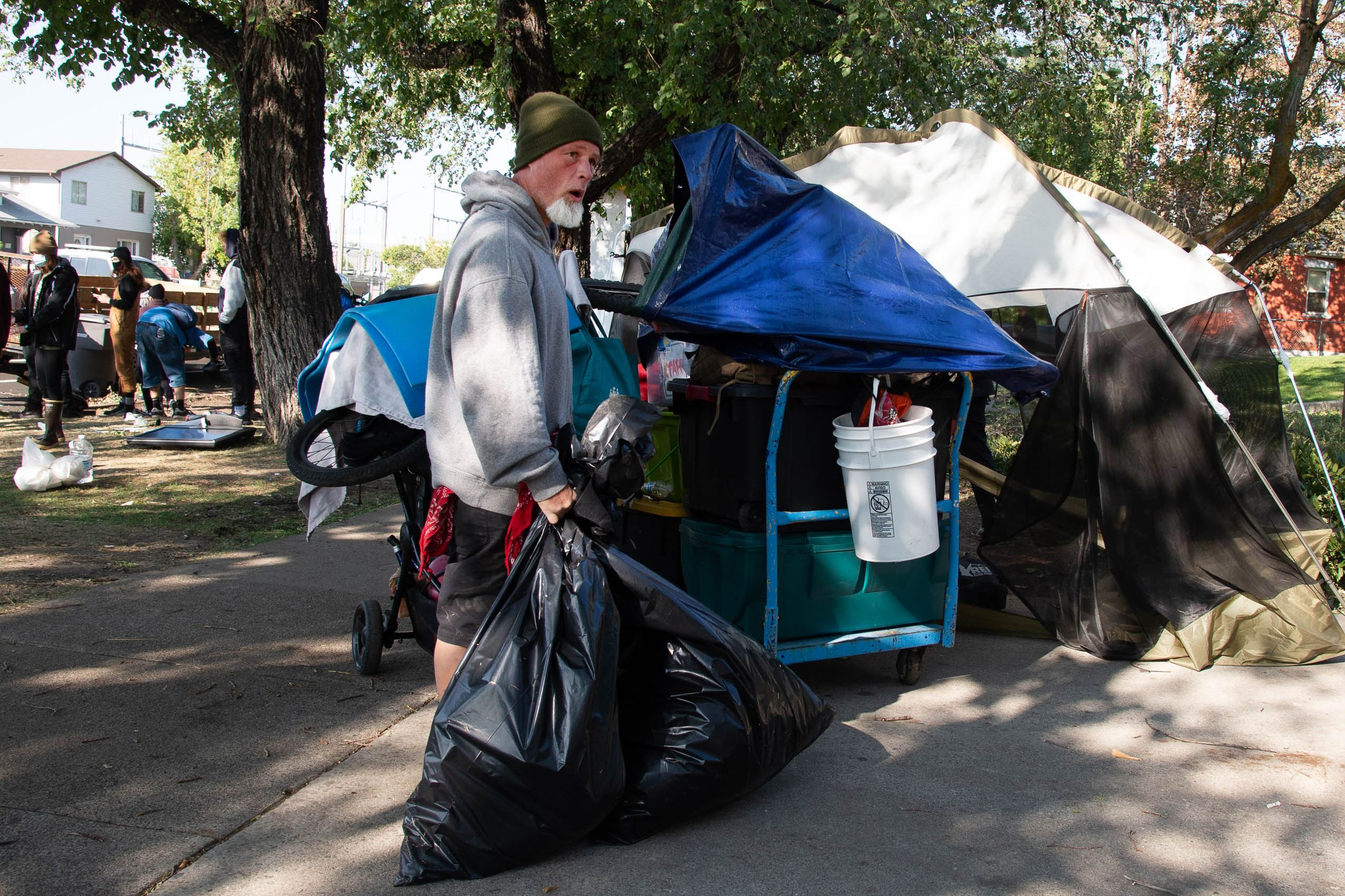 (Francisco Kjolseth  |  The Salt Lake Tribune) Richard Ryan packs up his belongings as the Salt Lake County Health Department forces a clean up of homeless camps at Taufer Park in Salt Lake City on Thursday, Sept. 10, 2020.