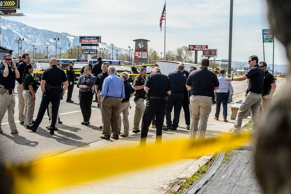 (Trent Nelson | The Salt Lake Tribune) Law enforcement at the scene of a shootout near 3300 South State Street in South Salt Lake on Monday April 8, 2019.