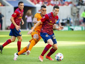 (Isaac Hale   Special to The Tribune) Real Salt Lake defender Aaron Herrera (22) and Houston Dynamo midfielder Darwin Ceren (24) compete for possession of the ball during a MLS game between Real Salt Lake and Houston Dynamo FC at Rio Tinto Stadium in Sandy on Saturday, June 26, 2021.