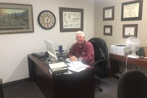 (Photo courtesy of Jeff Chappell)  Dr. Jeff Chappell, the only doctor at a community health center in Wayne County, relaxes in his office, a rare moment nowadays amid new responsibilities, challenges and worries due to the coronavirus.