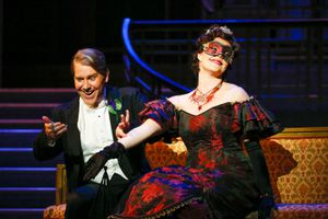"""(Courtesy photo by Kent Miles for Utah Opera) Eisenstein, played by Daniel Belcher, tries to flirt with a Hungarian countess at a party — unaware that she's actually his wife, Rosalinda, played by Sara Gartland, in a scene from Utah Opera's """"Die Fledermaus."""""""