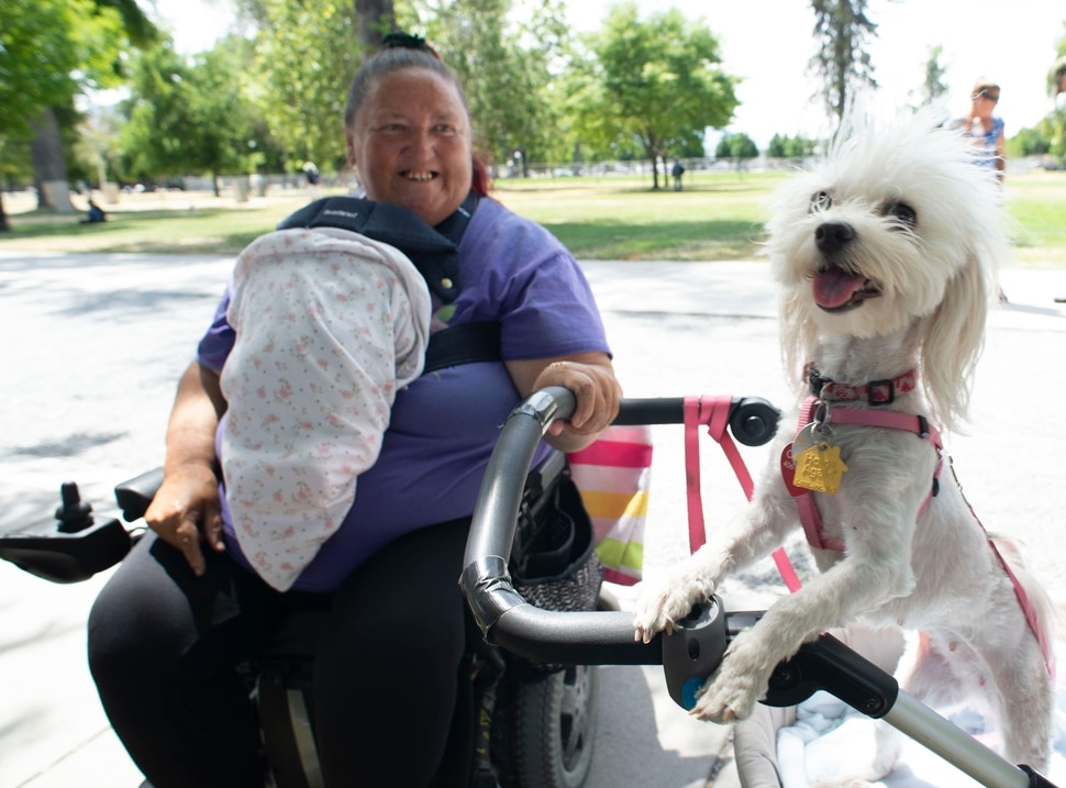 (Rick Egan | The Salt Lake Tribune) Dotty Antonio picks up doggie treats and some food for her dog Carmela from the Sunday Street Dawg Crew, a group that gives out food, treats, leashes and things fort pets of homeless people. Sunday, July 7, 2019.