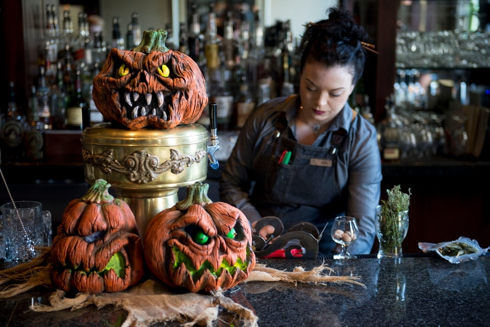(Jeremy Harmon | The Salt Lake Tribune) Bartender Erica Taylor works at the Vault Bar at Hotel Monaco on Tuesday, Oct. 15, 2019. The downtown Salt Lake City bar has partnered with Nightmare on 13th haunted house to create a Halloween themed experience for bar patrons.