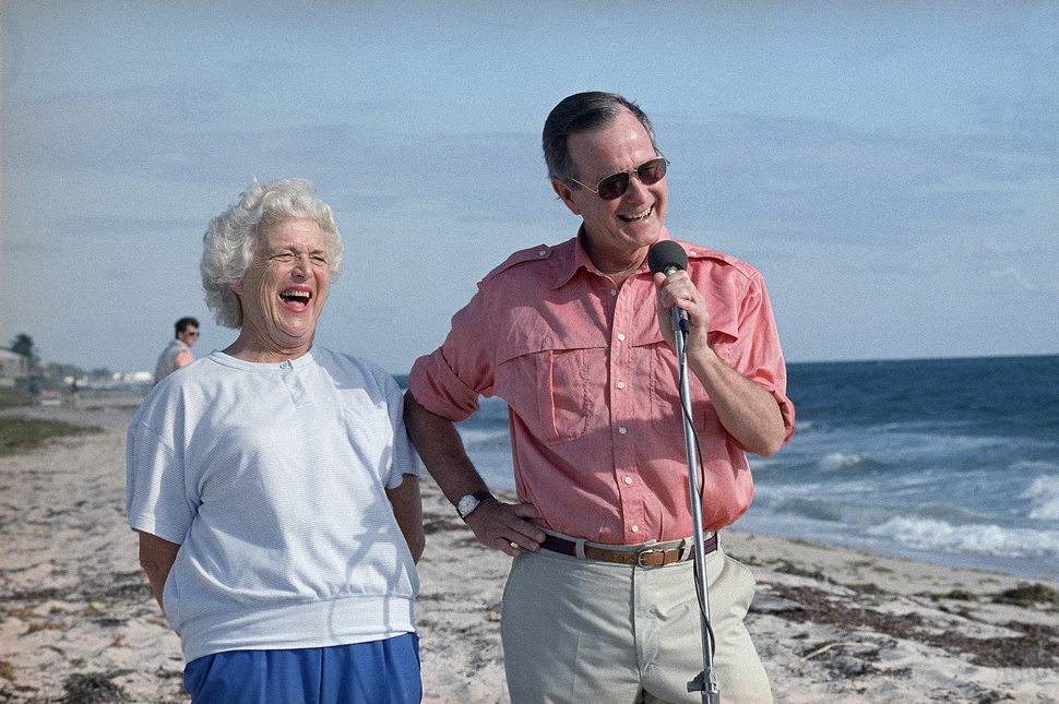 FILE - In this Nov. 14, 1998, file photo, President-elect George H.W. Bush and his wife, Barbara, are shown during a morning beachfront news conference in Gulf Stream, Fla. A family spokesman said Tuesday, April 17, 2018, that former first lady Barbara Bush has died at the age of 92. (AP Photo/Kathy Willens, File)