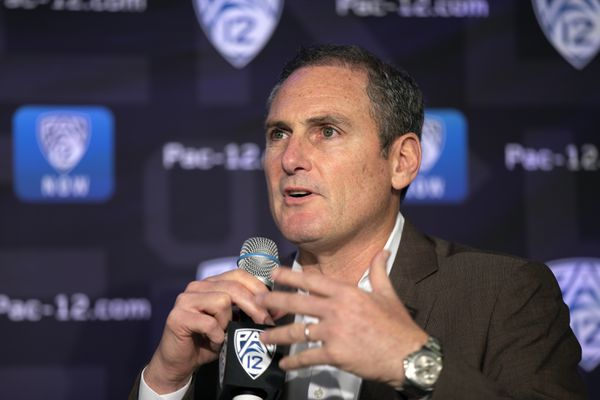 FILE - In this Oct. 7, 2019, file photo, Pac-12 Commissioner Larry Scott speaks to reporters during the Pac-12 Conference women's NCAA college basketball media day in San Francisco. The conference announced on Wednesday evening that Larry Scott will step down from his position on June 30. (AP Photo/D. Ross Cameron, File)