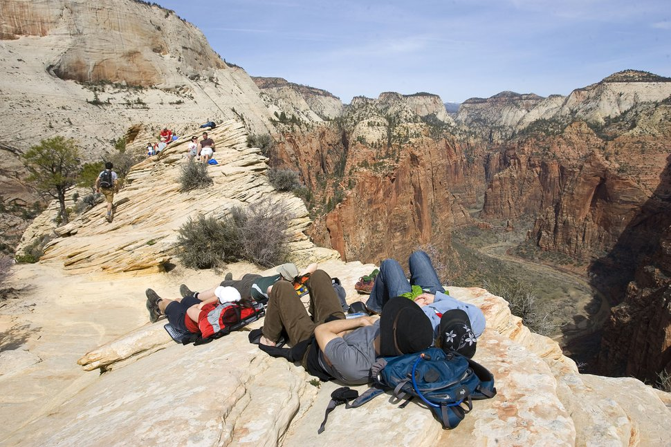 (Al Hartmann | Tribune file photo) Hikers rest on the Angels Landing trail in Zion National Park in 2009.