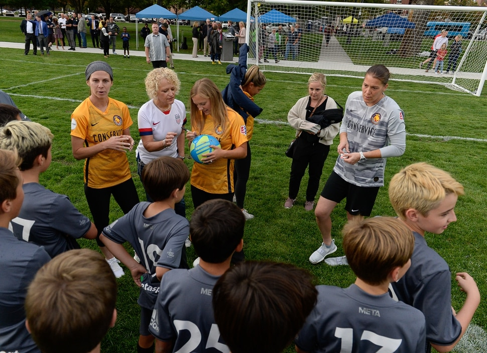 (Francisco Kjolseth | The Salt Lake Tribune) Salt Lake City Mayor Jackie Biskupski gets her ball signed by Utah Royals FC players as they are joined by the Metasport FC youth soccer league during a jubilee in celebration of the recently completed improvements at Pioneer Park on Tuesday, September 10, 2019.