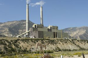 (Tribune file photo by Al Hartmann) Utah is a major producer of fossil energy, as evidenced by the coal-fired Huntington Power Plant, pictured here at the edge of a gas field in Emery County. State officials are pushing back against President Joe Biden's policies aimed at lowering carbon emissions from the kinds of hydrocarbons produced in Utah.