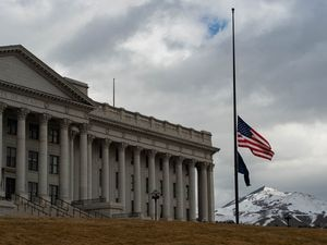 (Francisco Kjolseth  | The Salt Lake Tribune) In coordination with a proclamation from President Biden, Gov. Spencer Cox orders the lowering of the flag as it flies at half-staff on Tuesday, Feb. 23, 2021 at the Utah Capitol in memory of the grim milestone reached of 500,000 American lives lost to COVID-19.