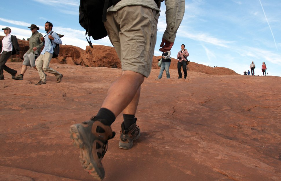 Francisco Kjolseth | The Salt Lake Tribune A steady flow of traffic, with visitors from all over the world make their way to and from Delicate Arch, one of the most visited in Arches National Park. Francisco Kjolseth | The Salt Lake Tribune Parking spaces are at a premium during the peak season at the Devils Garden Trailhead in Arches National Park as visitors fill every available spot recently. The infrastructure of Arches National Park was created based on an annual average visitation of 75,000. The park surpassed 1 million visitors in 2010 and is steadily climbing. Officials at Arches are considering options to reduce the number of cars in the park and a shuttle system is one option. However, it would be expensive and, if visitation numbers keep going up, it could soon be obsolete.Ê