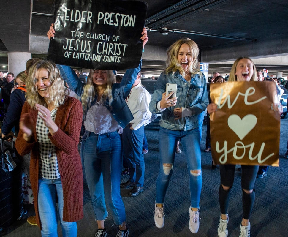 (Rick Egan | The Salt Lake Tribune) Members of the Preston family form Kaysville cheer for Elder Kaleb Preston as he returns from his mission in the Philippines, at Salt Lake City International Airport, Sunday, March 22, 2020.