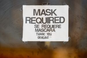 (Trent Nelson  |  The Salt Lake Tribune) A sign indicates masks are required at a store in West Valley City on Tuesday, March 16, 2021.