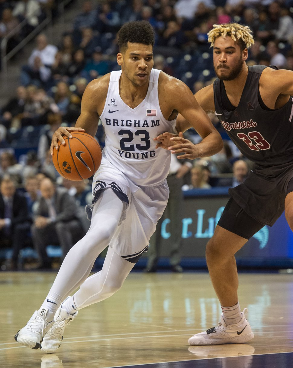 (Rick Egan | Tribune file photo) Brigham Young Cougars forward Yoeli Childs (23) takes the ball down the middle as, Santa Clara Broncos center Ezekiel Richards (23) defends, in basketball action between Brigham Young Cougars and Santa Clara Broncos at the Marriott Center in Provo, on Jan. 12, 2019.