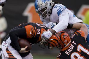 Detroit Lions defensive end Ezekiel Ansah (94) sacks Cincinnati Bengals quarterback Andy Dalton (14) during the first half of an NFL football game, Sunday, Dec. 24, 2017, in Cincinnati. (AP Photo/Frank Victores)