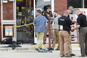 Scott Sommerdorf | The Salt Lake TribuneFour police officers were taken to the hospital after trying to save the life of a man who poured gasoline over himself in the bathroom of the Chevron Top Stop at 300 West and 200 South in Kaysville, Thursday, April 5, 2018. The man was taken in a helicopter to UofU Medical Center. A piece of clothing - perhaps a pair of pants - lays on the cement outside the convenience store as police conduct their investigation.