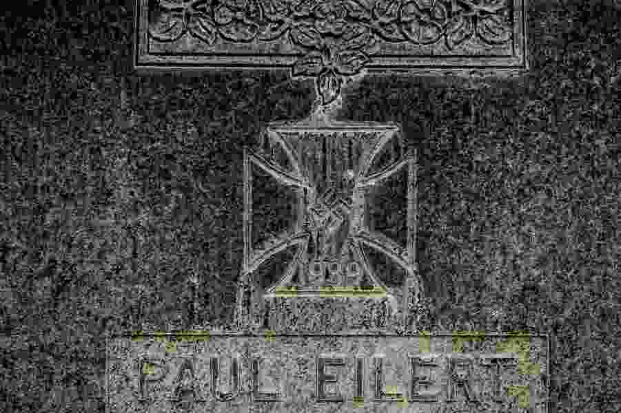 A swastika adorns a gravestone at a Utah military cemetery. Members of Congress want it removed.