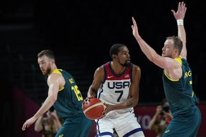 (Eric Gay | AP) United States's Kevin Durant (7), center, is pressured by Australia's Joe Ingles (7), right, during men's basketball semifinal game at the 2020 Summer Olympics, Thursday, Aug. 5, 2021, in Saitama, Japan.