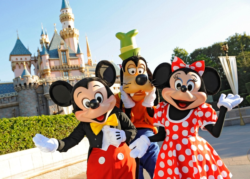 (Photo courtesy Disneyland Resort) Mickey Mouse, Goofy and Minnie Mouse welcome visitors in front of the Sleeping Beauty Castle at Disneyland.