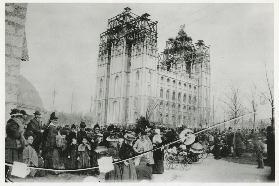 (Tribune file photo) People gather outside the Salt Lake Temple for the capping ceremony on April 6, 1892.
