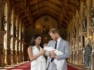 FILE - In this Wednesday May 8, 2019 file photo, Britain's Prince Harry and Meghan, Duchess of Sussex, during a photocall with their newborn son, in St George's Hall at Windsor Castle, Windsor, south England. Prince Harry and his wife Meghan are ending their lives as senior members of Britain's royal family and starting an uncertain new chapter as international celebrities and charity patrons. In January the couple shocked Britain by announcing that they would step down from official duties, give up public funding, seek financial independence and swap the U.K. for North America. The split becomes official on March 31. (Dominic Lipinski/Pool via AP, file)