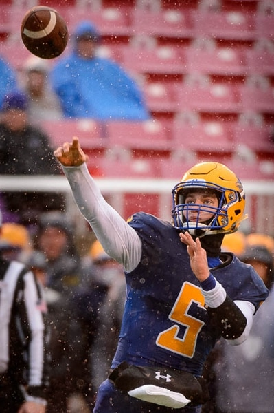 (Trent Nelson | The Salt Lake Tribune) Orem's Cooper Legas (5) passes as Orem faces Mountain Crest in the Class 4A High School State Football Championship game in Salt Lake City, Friday November 17, 2017.