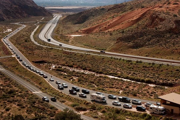 (Leah Hogsten   The Salt Lake Tribune) In this 2013 photo, visitors line up to get into Arches National Park.