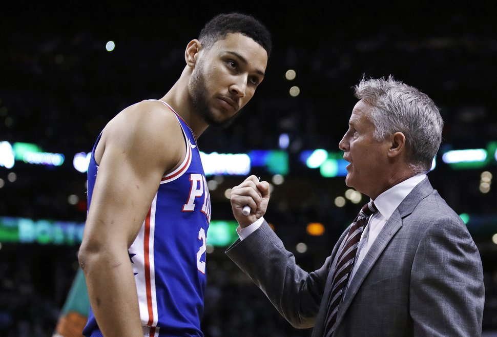 Philadelphia 76ers coach Brett Brown, right, talks with guard Ben Simmons before Game 5 of the team's NBA basketball playoff series against the Boston Celtics in Boston, Wednesday, May 9, 2018. (AP Photo/Charles Krupa)