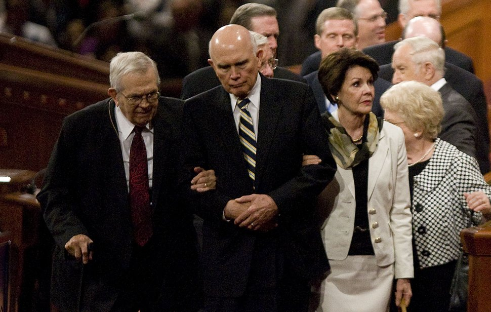 Jeremy Harmon | The Salt Lake Tribune Elder Dallin H. Oaks, center, helps President Boyd K. Packer to his wheelchair following the Saturday morning session of the 181st Semiannual General Conference of The Church of Jesus Christ of Latter-day Saints on Saturday, Oct. 1, 2011.
