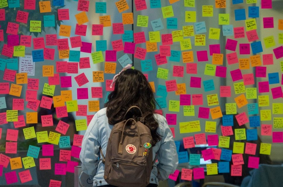 (Rick Egan | The Salt Lake Tribune) Brigham Young University students gathered at the Tanner Building on campus Tuesday to write messages of love and support and hand out flowers, after a student attempted suicide in the building on Monday.