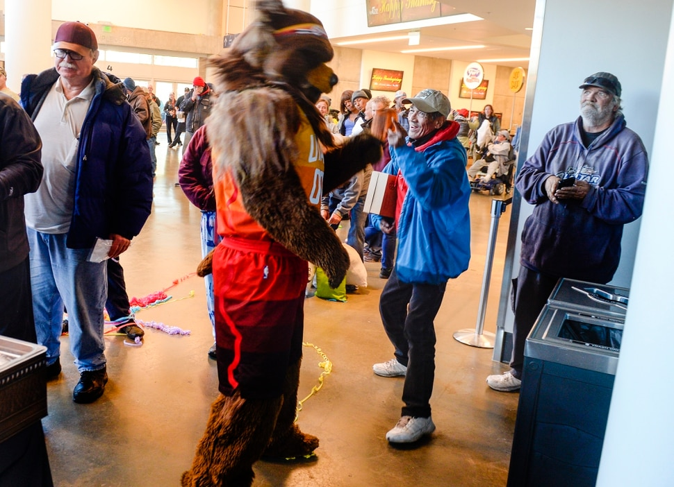 """Leah Hogsten   The Salt Lake Tribune Valentin Guzman shares a laugh with Jazz Bear at the Utah Jazz and the Larry H. Miller Group sponsored annual """"We Care – We Share"""" Thanksgiving Meal for local homeless and low-income families, Monday, Nov 19, 2018."""