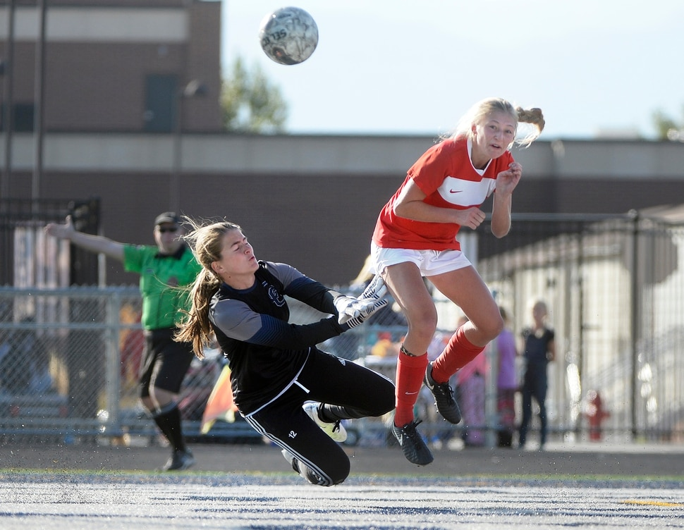 (Scott Sommerdorf | The Salt Lake Tribune) East forward Emily Jensen heads the ball past Corner Canyon goalkeeper Allison Stanley during first half play. East beat Corner Canyon 4-1 in a Class 5A girls' soccer state quarterfinal, Thursday, October 12, 2017.