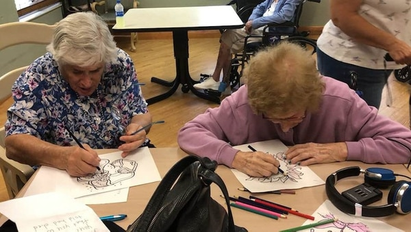 (Photo courtesy of Elliot Loewenstern) Joanne Loewenstern (left) and her mother, 100-year-old Lillian Ciminieri, coloring for the first time.