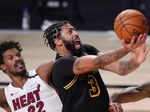 (Mark J. Terrill | AP) Los Angeles Lakers forward Anthony Davis shoots past Miami Heat forward Jimmy Butler during the second half in Game 5 of basketball's NBA Finals in Lake Buena Vista, Fla., Oct. 9, 2020.