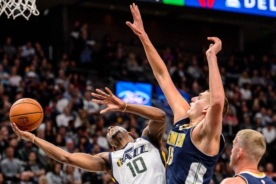 (Trent Nelson | The Salt Lake Tribune) Utah Jazz guard Alec Burks (10) shoots as the Utah Jazz host the Denver Nuggets, NBA basketball in Salt Lake City, Wednesday October 18, 2017.