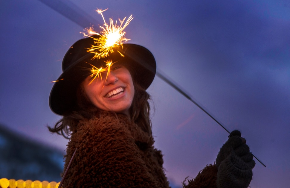 (Rick Egan | The Salt Lake Tribune) Verena Puhm, a director and writer from from Los Angeles plays with a sparkler at the first-ever Sundance bonfire, a community gathering on Swede Alley, in Park City, Thursday, Jan. 30, 2020.