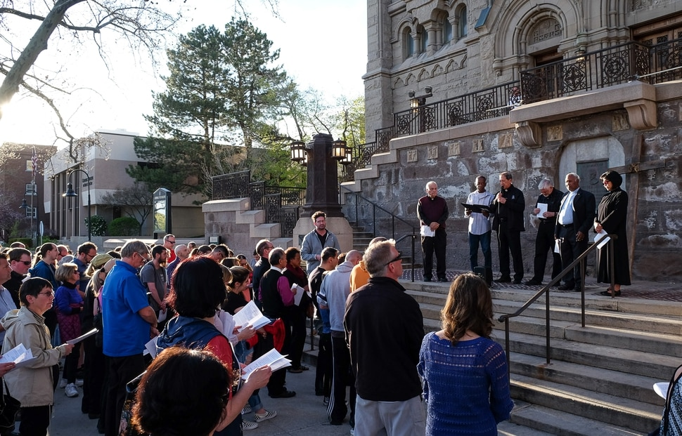(Francisco Kjolseth | The Salt Lake Tribune) Christians gather on the steps of the Cathedral of the Madeleine before marching through streets of Salt Lake City on Good Friday to symbolically mark Jesus' carrying the cross to his crucifixion.