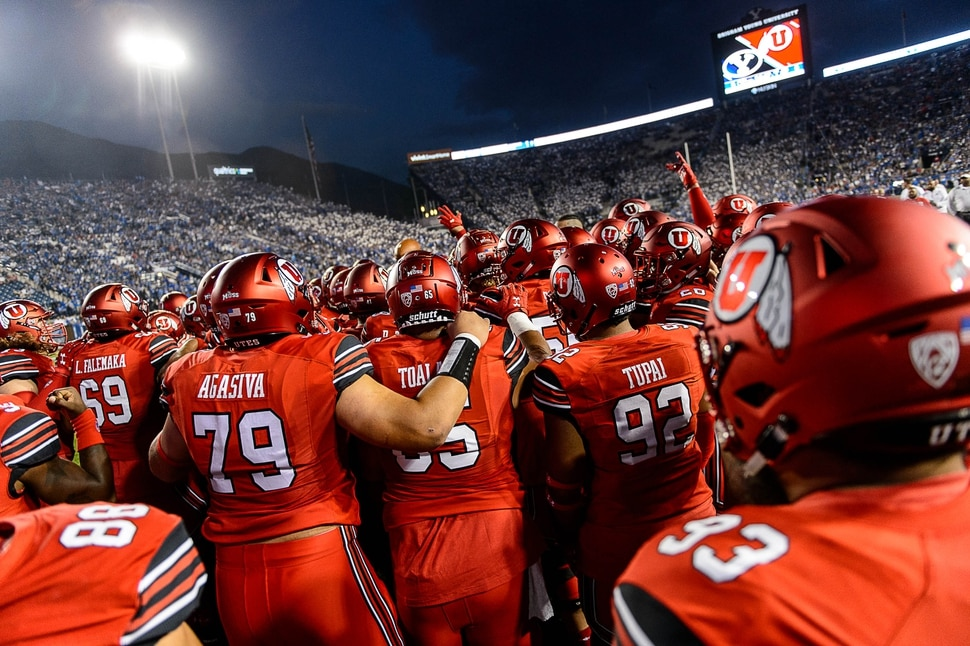 (Trent Nelson | The Salt Lake Tribune) Utah players huddle before the game as BYU hosts Utah, NCAA football in Provo, Saturday September 9, 2017.