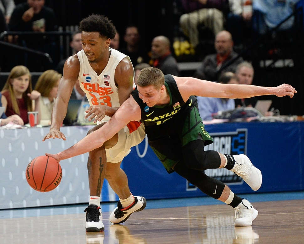 (Francisco Kjolseth | The Salt Lake Tribune) Syracuse Orange forward Elijah Hughes (33) and Baylor Bears guard Makai Mason (10) battle over a ball as Syracuse faces Baylor in their first round menÕs NCAA March Madness tournament game at Vivint Smart Home Arena in Salt Lake City on Thursday, March 21, 2019.