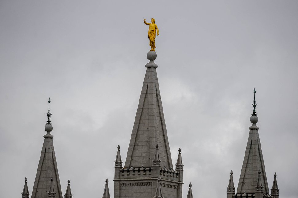 (Trent Nelson | The Salt Lake Tribune) The statue of Moroni atop the Salt Lake Temple lost its trumpet in an earthquake Wednesday, March 18, 2020.