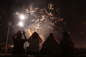 (Rick Egan     Tribune file photo) Salt Lake spectators enjoy a fireworks display, Sunday, July 4, 2010. Discussion of a statewide fireworks ban raises questions about whether such a ban will help prevent wildfires.
