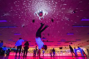 (Rick Egan   The Salt Lake Tribune) Jase Lawson does a handstand as he skates during the Disco Skate at Classic Skating and Fun Center in Orem on Saturday, Dec. 26, 2020.