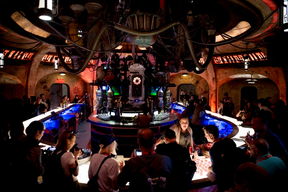 (Jeremy Harmon | The Salt Lake Tribune) Patrons sample drinks at Oga's Cantina at Star Wars: Galaxy's Edge in Anaheim, Ca. on Wednesday, May 29, 2019. The cantina is reminiscent of the one in the original Star Wars film from 1977.