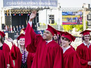(Isaac Hale | Special to The Tribune) Graduates wave to family and friends while their processional moves onto the field during Herriman High School's graduation ceremony held Thursday, June 3, 2021.