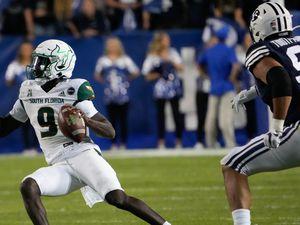 (Francisco Kjolseth | The Salt Lake Tribune) South Florida quarterback Timmy McClain, left scrambles during Saturday's game against BYU  at LaVell Edwards Stadium in Provo, Saturday, Sept. 25, 2021.