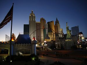 (John Locher | AP file photo)  The sun sets behind casinos and hotels along the Las Vegas Strip in Las Vegas on April 28, 2020.