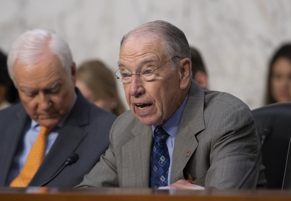 Senate Judiciary Committee Chairman Chuck Grassley, R-Iowa, joined by Sen. Orrin Hatch, R-Utah, left, opens a hearing on the Trump administration's policies on immigration enforcement and family reunification efforts, on Capitol Hill in Washington, Tuesday, July 31, 2018. (AP Photo/J. Scott Applewhite)
