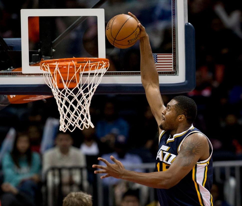 Utah Jazz forward Derrick Favors scores against the Atlanta Hawks in the first half of an NBA basketball game Wednesday, Nov. 12, 2014, in Atlanta. (AP Photo/John Bazemore)