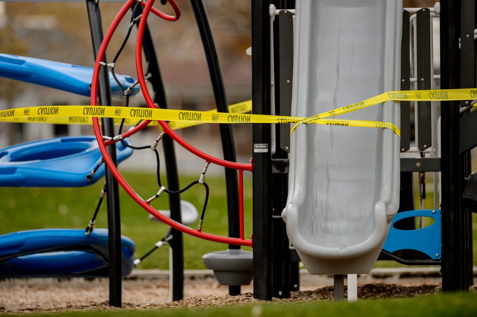 (Trent Nelson | The Salt Lake Tribune) Yellow caution tape covers the playground at Poplar Grove Park in Salt Lake City on Wednesday, April 1, 2020.