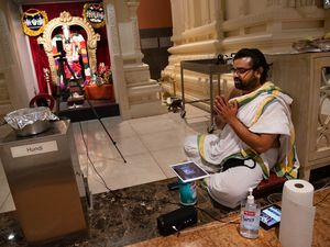(Francisco Kjolseth     The Salt Lake Tribune) The new tools of ceremony, Hindu priest Sathish Nivarthi keeps Clorox wipes and hand sanitizer close while using multiple screen devices and a camera to broadcast a ceremony live online on Thursday, Sept. 24, 2020, at the Sri Ganesha Hindu Temple in South Jordan. Due to the coronavirus pandemic, the temple remains closed on weekdays with limited time slots available to visit on the weekends in an effort to promote safety.