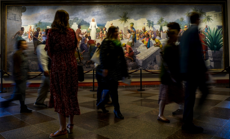 Leah Hogsten | The Salt Lake Tribune Members file into the 189th Annual General Conference of The Church of Jesus Christ of Latter-day Saints in Salt Lake City in front of a painting titled Jesus Christ Visits the Americas by John Scott.